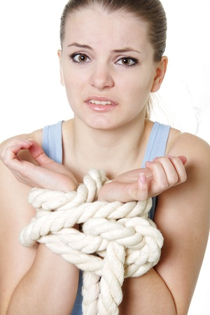 woman tied: young bounded woman over white Stock Photo
