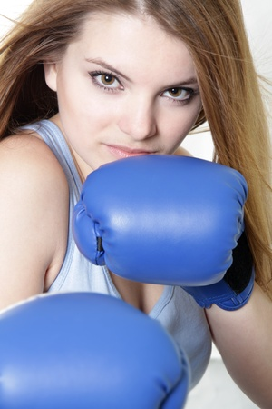 short gloves: young attractive woman boxer over white Stock Photo