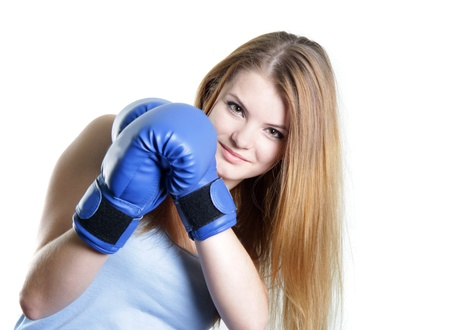 girl punch: young attractive woman boxer over white Stock Photo