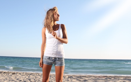young beautiful woman on beach background