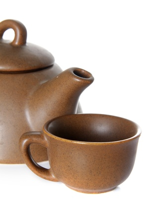 teapot and teacup over white photo