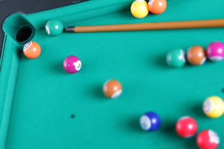billiard balls and cue on table photo