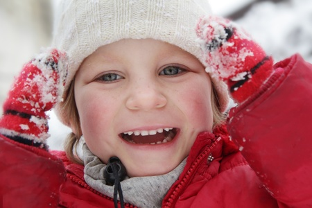 young cute girl having fun on natural winter background photo