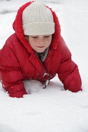 young cute girl having fun in snow photo