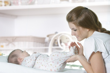 young mother with baby at home photo