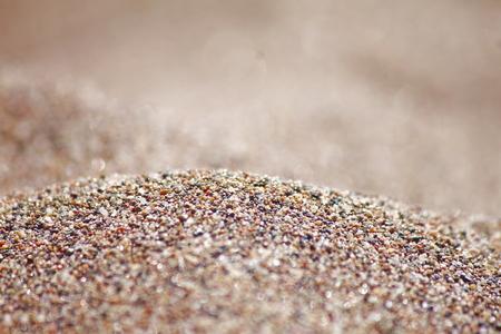Sea run-multicolored sand on the beach close-up.