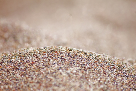Sea run-multicolored sand on the beach close-up.