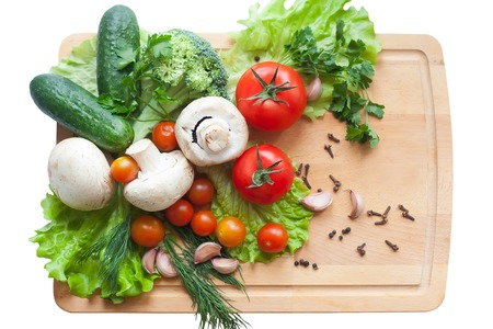 dill and parsley: Vegetables on wood background, mushrooms, cucumbers, tomatoes, broccoli, lettuce, dill, parsley and pepper on isolated white background Stock Photo