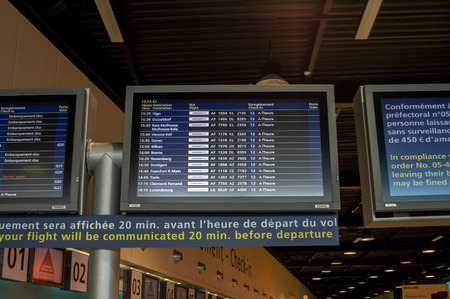 arrival departure board: Check-In, Departure Arrival information board at Charles de Gaulle Airport Paris, France.