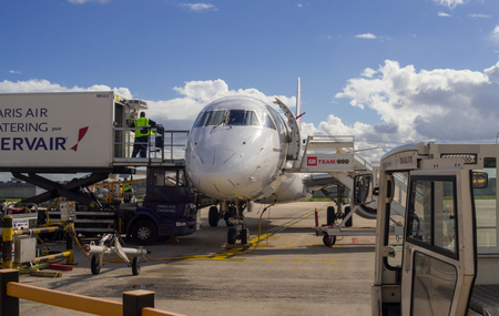 charles de gaulle: AirFrance HOP! Embraer 170 handling before the flight in Charles de Gaulle Airport Paris, France. Editorial