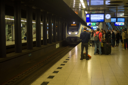 schiphol: Underground Train Station and Passengers in Amsterdam Schiphol Editorial