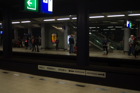 subway platform: Passengers at Subway Platform in Amsterdam Schiphol