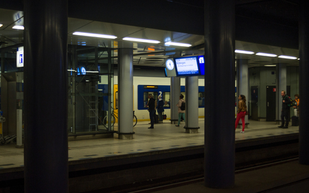 subway platform: Passengers at Subway Platform in Amsterdam Schiphol Railway Station