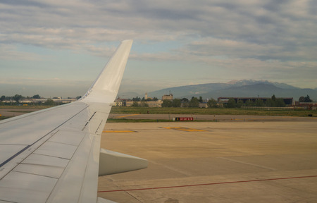 airfield: Aircraft wingtip and Airfield vefore taking off