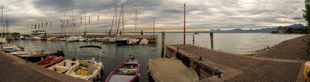 sailingboat: Panoramic view on sunset over Yacht harbour on the Garda Lake in Bardolino Verona, Veneto, Italy.