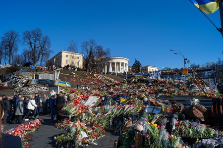 dignity: People bring flowers and candles at Maidan Nezalezhnosti in Kiev (Ukraine) after Revolution of Dignity. Photo was made 2 weeks after massive killing of Ukrainian Patriots by goverment forces.