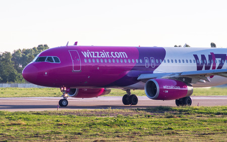 Close-up side view of passenger aircraft Airbus A320 by WizzAir Airlines Copy Space. Airbus A320-232 (HA-LWR). Kyiv, Ukraine - September 8, 2016 Editorial