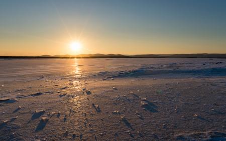 frozen lake: Beautiful sunset on a frozen lake. Winter came frozen lake.