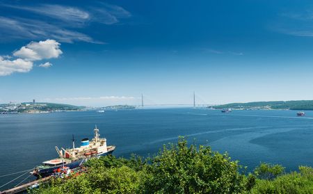noon: The Russian city of Vladivostok. Vladivostok, hot summer afternoon. Golden Horn Bay.