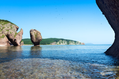 ridge of wave: Rest in the bay named Dubovay. Rocks in the Japanese Sea. Stock Photo