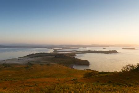 Russian Far Eastern peninsula named Krabbe. Sunrise on the peninsula on behalf of Krabbe in Japanese sea. 版權商用圖片