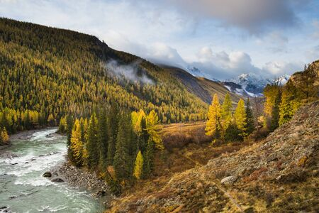 Beautiful Chuya River Valley is the Republic of Altai Russia. A mountain road along the Chuya River. Stock Photo