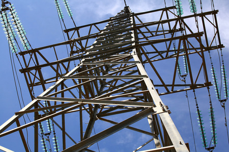 voltage gray: The metal structure of the electrical towers in the blue sky.