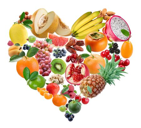 The fruits in a form of heart are in a white background photo
