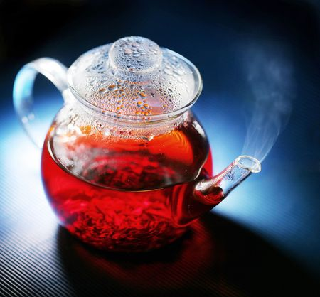 Teapot; tea leaves photo