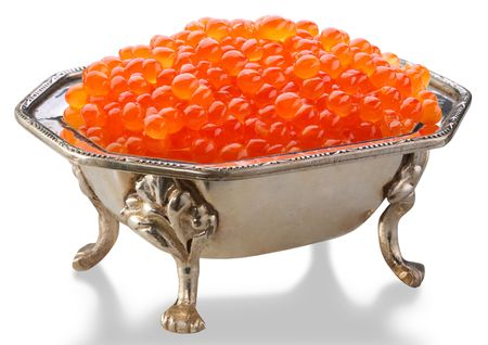 Red caviar is in a silver bowl photo