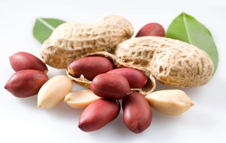 Peanut with pods and leaves on a white background.