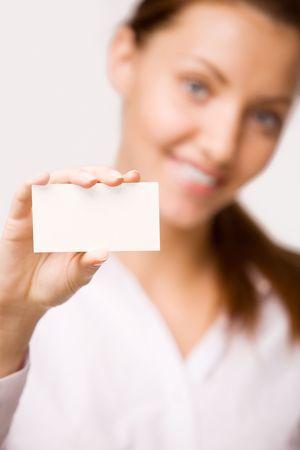 A girl holds a card photo