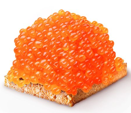 Red caviar on the piece of bread photo