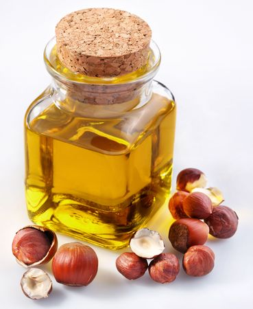 hazel: filbert oil with nuts on a white background