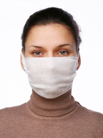 Young woman in medical mask on a white background photo