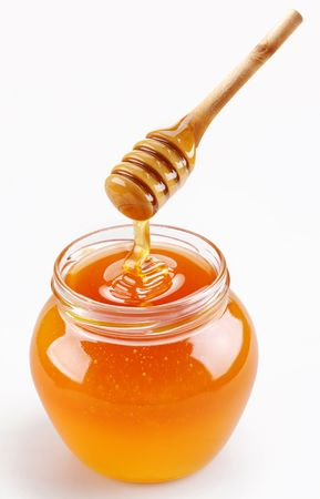 glass jar: Full honey pot and honey stick