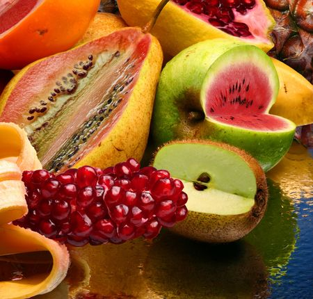 Concept photo of the modified fruits on a mirror photo