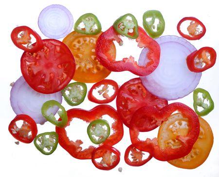 brighten: Brighten tomato, pepper, onion slices  on a white Stock Photo