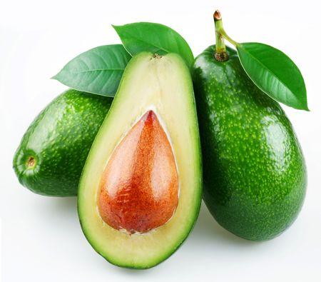 avocado: Avocado con foglie su uno sfondo bianco Archivio Fotografico