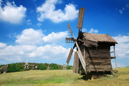 Old windmills in the  summer countryside photo