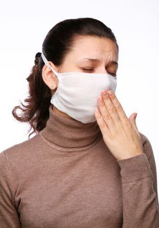 indisposition: Coughing woman in a medical mask on a white background Stock Photo