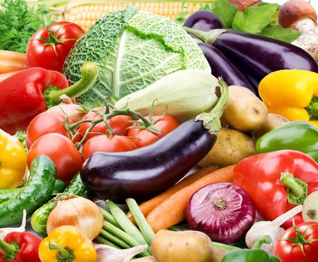 Colourful bright background consists of different vegetables photo
