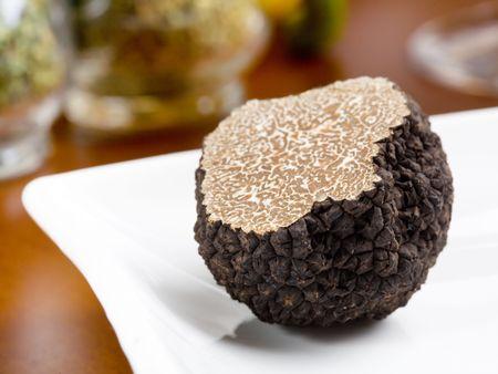 Mushroom of truffle on a white dish