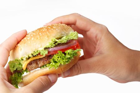 hands hold a cheeseburger on a white background Stock Photo - 6305944