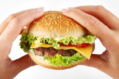 steak sandwich: hands hold a cheeseburger on a white background Stock Photo