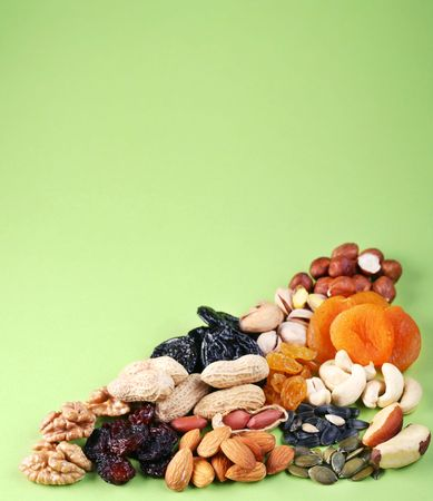 Groups of various kinds of dried fruits on green background Stock Photo - 6606738
