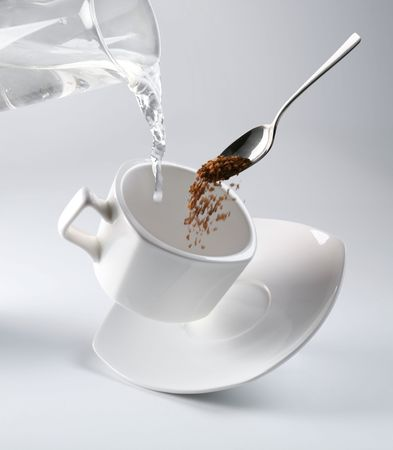 kettle: White cup of black coffee