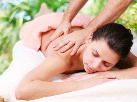 Young woman gets a massage. Eyes are closed. photo