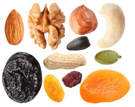 Close seeds and dried fruits on white background Stock Photo - 6606827