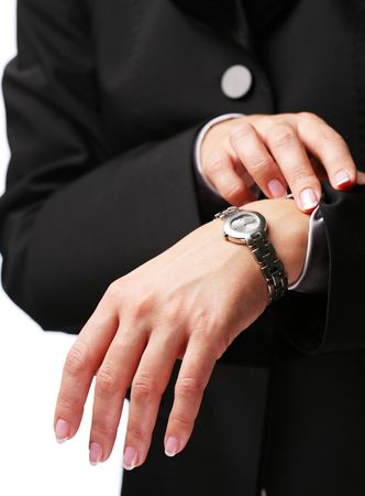 Businesswoman looks at his watch Stock Photo - 6606775